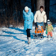 young family having fun in the snow
