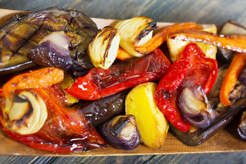 Grilled vegetables in wooden bowl.