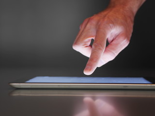 male hand touch digital tablet