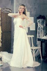 Bride makes fitting in a vintage design studio