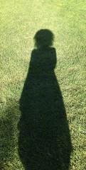 lady shadow on grass