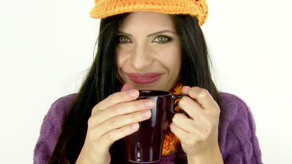 Woman drinking mug of coffee looking and smiling