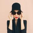 Portrait of elegant lady in a stylish hat