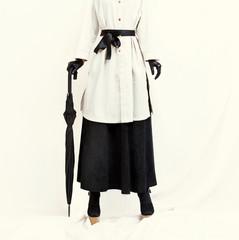Retro styled fashion girl. Charlie Chaplin style.