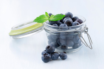 Ripe blueberries on wooden background