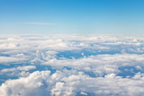 horizon above white clouds in blue sky