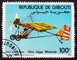Leinwandbild Motiv Postage stamp Djibouti 1984 Motorized Hang Glider