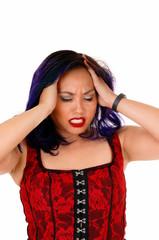 Asian woman with headache.