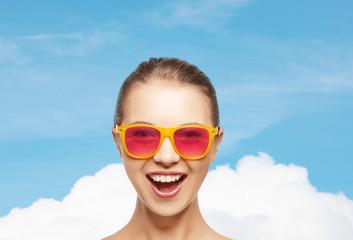 happy teenage girl in pink sunglasses