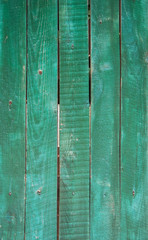 Old green wooden fence closeup