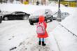 kid girl walks from school  on winter day