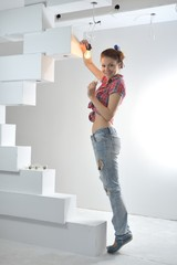 Young beautiful woman twists a bulb
