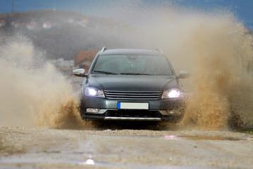 Car drives through water