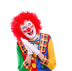 amazing clown looking up to the white background