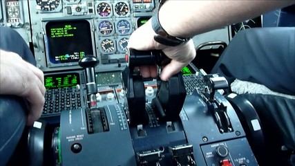 Commercial airplane pilot's hand pushing thrust during take off