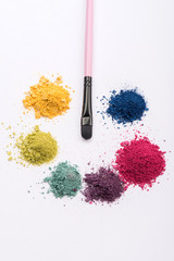 Close-up view of  professional make-up brush surrounded by heaps