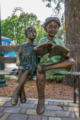Sculpture boy and girl on a bench