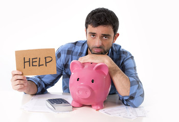 man in stress with piggy bank in bad financial situation