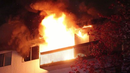 Residential building's balcony fully involved in heavy flames