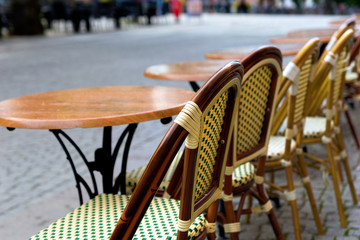 empty chairs and tables at street café
