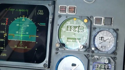 Commercial aircraft altimeter showing altitude increase