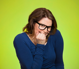 Anxious insecure woman, isolated on green background