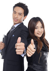 young couple business people holding their thumbs up