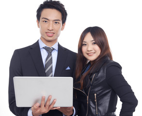 young asian business couple with laptop posing