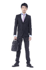 young business man carrying a suitcase , Vertical shot.