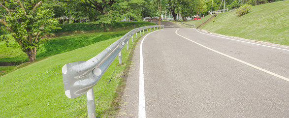 panoramic view of nice green hill and road