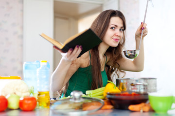 young adult woman cooking veggie lunch