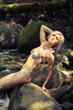 beautiful girl in a bikini among the rocks