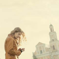 Beautiful girl praying on the background of the church