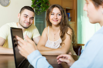 couple filling questionnaire for employee with laptop