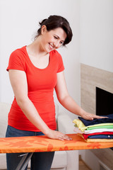 Happy woman doing housework