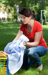 Young housekeeper with laundry outdoors