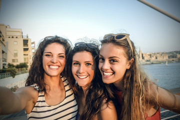 three friends taking a souvenir photo