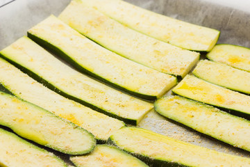 Sliced zucchinis ready to be baked