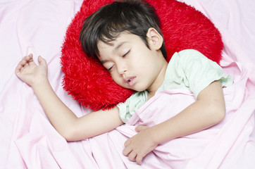 Little boy sleeping at night