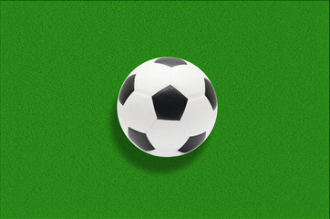 Soccer ball in green grass background