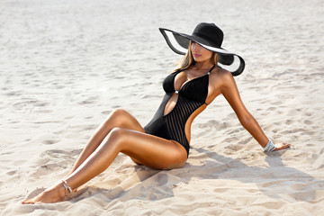 Young woman in swimsuit on the beach