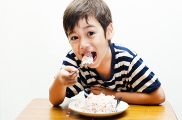 Little boy eating rice happy face
