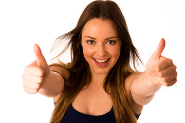 Beautiful asian caucasian woman gesturing success showing thumb
