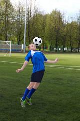 Boy plays football