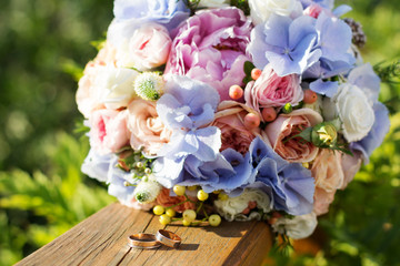 Wedding bouquet of roses and blue fresia
