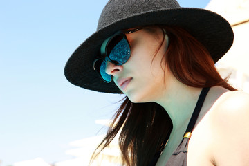 Closeup portrait of a beautiful woman in sunglasses