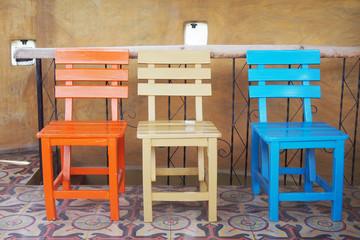 wooden chairs on ceramic tiles floor