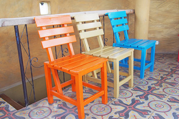 wooden chairs on ceramic tiles floor