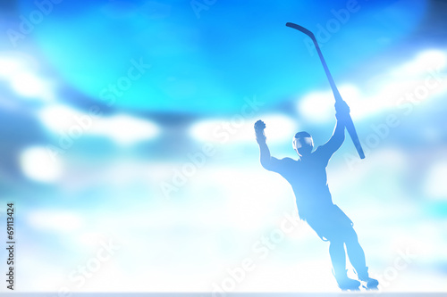 Hockey player celebrating goal, victory with hands and stick up - 69113424