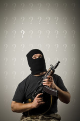 Man with gun and question marks.